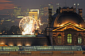 View from the department store La Samaritaine towards the Louvre, Arc de Triomphe and Grande Arche La Defense, illumated at night, historical axis, Paris, France