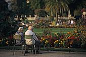 Elderly couple looking at the flowers in the Jardin du Luxembourg, largest public park in Paris, 6e Arrondissement, Paris, France