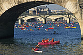 People in kayaks and canoes on the Seine river, Paris, France, Europe