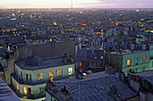 View over roofs of Paris onto the Eiffel Tower in the evening, Montmartre, Paris, France, Europe