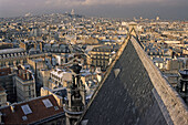 View from the roof of Eglise Saint Eustache church over roofs of in evening sun, skyline, 1e Arrondissement, Paris, France, Europe