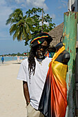 Jamaica Negril beach cool Rastafari man in front of fashion shop