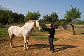 Pepe with Spanish Horse, Agrotourismo Alfatx Finca Hotel, near s'Esgleieta, Mallorca, Balearic Islands, Spain