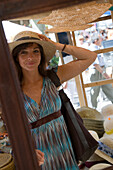 Julia Trying On Sun Hat at Soller Market, Soller, Mallorca, Balearic Islands, Spain