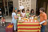 Children Selling Freshly Squeezed Orange Juice, Soller, Mallorca, Balearic Islands, Spain