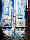 Aged, Careless, Carelessness, Cities, City, Closed, Color, Colour, Concept, Concepts, Daytime, Door, Doors, Exterior, Graffiti, Graffito, Nobody, Old, Old fashioned, Old-fashioned, Outdoor, Outdoors, Outside, Paint, Urban, Vandalism, Vertical, White, Wood