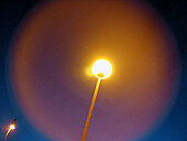 Center, Centre, Color, Colour, Concept, Concepts, Electricity, Energy, Exterior, Horizontal, Light, Low angle view, Night, Nighttime, One, Outdoor, Outdoors, Outside, Power, Round, Special effects, Street lamp, Street lamps, Symbolic, View from below, Wor