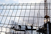 Activity, Blue-collar worker, Blue-collar workers, Cloud, Clouds, Color, Colour, Construction, Construction site, Construction sites, Dusk, Economy, Exterior, Human, Industrial, Industry, Outdoor, Outdoors, Outside, People, Person, Persons, Silhouette, Si