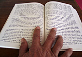 Adult, Adults, Africa, Ancient, Arabic, Book, Books, Close up, Close-up, Closeup, Color, Colour, Culture, Detail, Details, Figuig, Hand, Hands, Human, Indoor, Indoors, Interior, Morocco, North Africa, Object, Objects, One, One item, One person, Open, Peop
