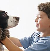 Contemporary, Dog, Dogs, Fondness, Grin, Grinning, Human, Indoor, Indoors, Inside, Interior, Kid, Kid