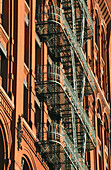 Fire escape on building in Soho. New York City, USA