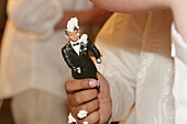 Bridegroom, Bridegrooms, Celebrate, Celebrating, Celebration, Celebrations, Close up, Close-up, Closeup, Color, Colour, Concept, Concepts, Contemporary, Detail, Details, Figure, Figures, Groom, Grooms, Hand, Hands, Hold, Holding, Human, Idea, Ideas, Indoo