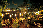 People dining in a restaurant near a river, Chiang Mai, North Thailand, Thailand