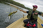 Activities, Activity, Adults, Alone, Angler, Apparel, Being, Casting, Catch, Caucasian, Clothes, Clothing, Color, Colour, Contemporary, Equipment, Fish, Fisher, Fisherman, Fishermen, Fishing, Free, Guy, Guys, Human, Individual, Lake, Leisure, Life, Lifest