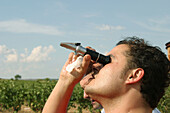Checking alcohol percentage in vineyard