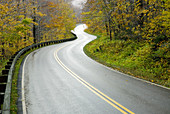 Rural road winding through Smugglers Notch Vermont USA