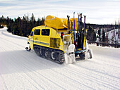 Yellowstone National Park, Wyoming: A snow coach drives up a park road.