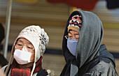 Korean women wearing an anti-pollution mask. Seoul, South Korea