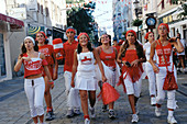 Youngsters dressed up with Gibraltars flag colors celebrating National day (September the 10th). Gibraltar. UK