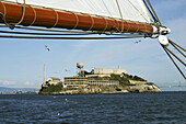 Alcatraz Island viewed from below the mast of a tall ship on San Francisco Bay, California. USA