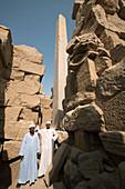 Caretakers pose for a photo near the obelisk at Karnak. Luxor. Egypt