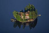Big house on small island in lake. Söderhamn. Sweden