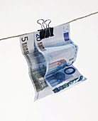 Banknote, Banknotes, Bill, Bills, Clip, Clips, Close up, Close-up, Closeup, Clothesline, Clotheslines, Color, Colour, Concept, Concepts, Currency, Daytime, Economy, EU, Euro, European Monetary Union, European Union, Euros, Exterior, Hang, Hanging, Idea, I