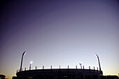 Sunset and clear sky behind stadium lights