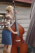 Bass fiddle, Blonde, Brown, Color, Colour, Concert, Contemporary, Fiddle, Girl, Gray, Hoedown, Jam session, Log cabin, Music, Musician, Out of doors, Woman, N17-564167, agefotostock