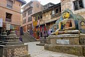 Giant Buddha in Swayambhunath temple. Kathmandu, Nepal
