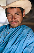 Absorbed, Adult, Adults, Askance, Color, Colour, Contemporary, Daytime, Exterior, Facial expression, Facial expressions, Goatee, Goatees, Hat, Hats, Headgear, Headshot, Headshots, Human, Latino, Latinos, Looking askance, Looking sideways, Male, Man, Men,