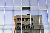Building reflected on façade. Paseo de la Castellana, Madrid, Spain