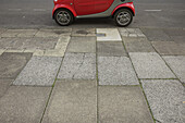 Smart car parked in urban street