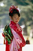 7 year old girl wearing kimono, Kitano Temmangu Shrine. Kyoto, Japan