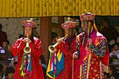 Musicians, Dance of the Judgement of the Dead (Raksha Mangcham) at the Paro Teschu festival, Paro Dzong Monastery, Paro Valley, Bhutan