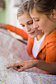 Young women, girls looking at a map, Travel, Mittenwald, Upper Bavaria, Bavaria, Germany