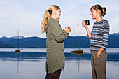Two young women at Lake Walchensee, Bavaria, Germany