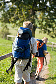 Two children (6-8 years) with backpack hiking