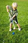 Boy (3-4) playing croquet, Bavaria, Germany