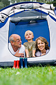 Grandparents and grandson in a tent