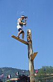 Man cutting log with an axe (raditional sport).  Asturias, Spain.
