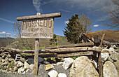 Wooden sign. Pueblo de Piornedo, Los Ancares, Lugo province, Galicia. Spain