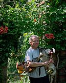 Gerhard Paucker, playing KOZOL bagpipe (made from a male goat), wendish folklore music band Drjewjanki, teacher in Burg, Upper Spreewald, Spreewald, Brandenburg, Germany