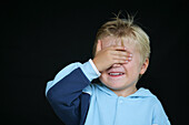 Young boy with hand covering eyes, Hiding, Child, Childhood, Family, Upbringing