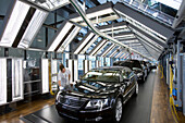 The transparent factory, automobile production plant owned by Volkswagen, modern factory designed to make the production line visible to the outside world. The luxury Phaeton automobile is built here. Quality check in the Lichttunnel. Neon light used to d