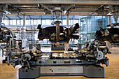 The transparent factory, automobile production plant owned by Volkswagen, modern factory designed to make the production line visible to the outside world. The luxury Phaeton automobile is built here. Preparation of the wedding, where the bodywork is scre