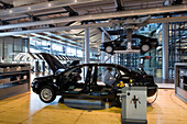 The transparent factory, automobile production plant owned by Volkswagen, modern factory designed to make the production line visible to the outside world. The luxury Phaeton automobile is built here. Fitting of the car ceiling, Dresden, Saxony, Germany,