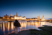Couple looking at Bruhl's Terrace, Frauenkirche, Dresden University of Visual Arts, Dresden Castle, Standehaus and Katholische Hofkirche at night, Dresden, Saxony, Germany