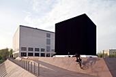 Gregor Schneider's The Black Cube in Hamburg. It is one of Germany's most contended artwork at present. The cube, placed between the original building of the museum 'Kunsthalle' and its new gallery, is a reminder of the major sanctuary of Islam, the Kaaba