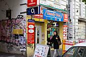 Shop with graffiti and advertisement in Susannenstrasse in Schanzenviertel, Hanseatic city of Hamburg, Germany, Europe